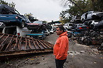 QUEENS, NY -- OCTOBER 19, 2013:  ____ , owner of Sunrise Auto Parts, looks at a structure he's had torn down in Willets Point on October 19, 2013 in Queens.  Photographer: Michael Nagle for The New York Times