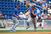 Biloxi Shuckers first baseman Nick Ramirez (14) rounds third as manager Carlos Subero (3) waves him around during the first game of a double header against the Pensacola Blue Wahoos on April 26, 2015 at Pensacola Bayfront Stadium in Pensacola, Florida.  Biloxi defeated Pensacola 2-1.  (Mike Janes/Four Seam Images)