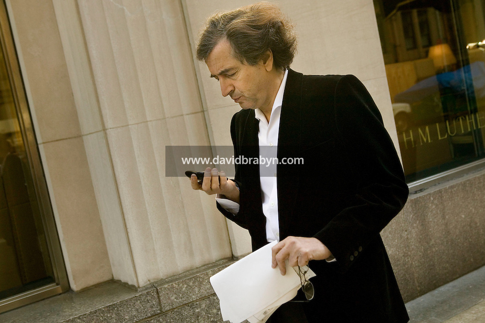 "26 January 2006 - New York City, NY - French thinker and author Bernard-Henri Levy walks in the street of New York City, USA, for the photographer, 26 January 2006. Levy is in the United States to promote his new book ""American Vertigo"" in which he figuratively retraces the 1831 American journey of his countryman Alexis de Tocqueville and reflects on the state of the US."