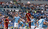 Calcio, Serie A: Lazio vs Roma. Roma, stadio Olimpico, 3 aprile 2016.<br /> Roma's Antonio Ruediger, top center, heads the ball during the Italian Serie A football match between Lazio and Roma at Rome's Olympic stadium, 3 April 2016.<br /> UPDATE IMAGES PRESS/Riccardo De Luca