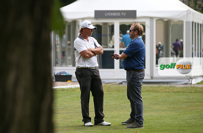 Media guru Michael Gibbons sneaks an informal chat with 2014 champion Mikael Lundberg (SWE) during the practice day ahead of the 2015 Lyoness Open powered by Greenfinity at the Diamond Country Club, Atzenbrugg, Vienna, Austria. 09/06/2015. Picture: Golffile | David Lloyd<br /> <br /> All photos usage must carry mandatory copyright credit (&copy; Golffile | David Lloyd)