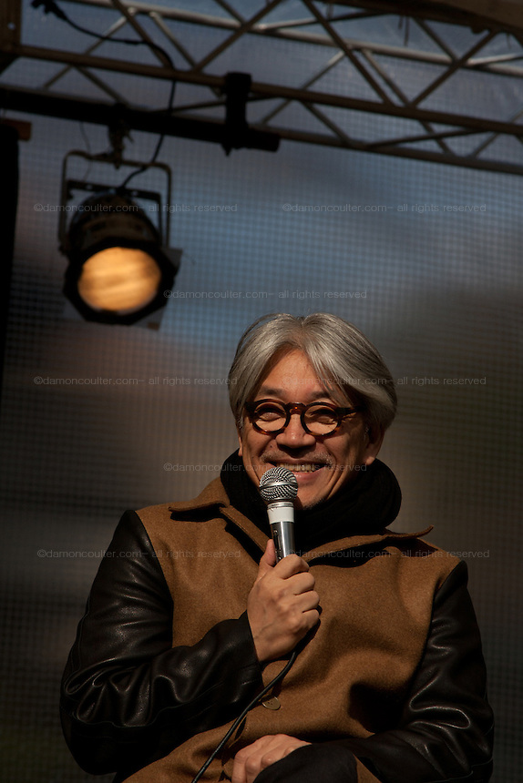 Japanese Music artist, Ryuichi Sakamoto talks at the Peace on Earth event in remembrance of the March 11th earthquake and tsunami in Tohoku. Hibiya Park, Tokyo, Japan. Sunday March 11th 2012