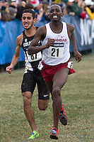Colorado's Ammar Moussa (87) races Arkansas' Stanley Kebenei to the finish line during the NCAA Cross Country Championships in Terre Haute, Ind. on Saturday, Nov. 22, 2014. (James Brosher, Special to the Denver Post)