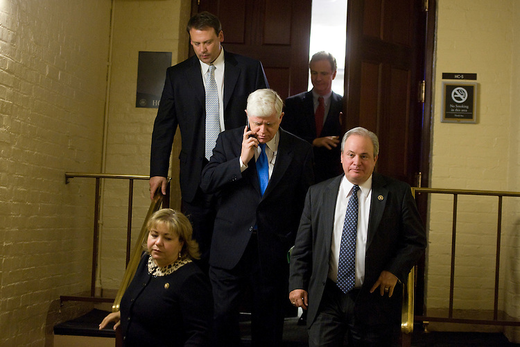 UNITED STATES - DECEMBER 16:  From left, Reps. Linda Sanchez, D-Calif., Heath Shuler, D-N.C., John Larson, D-Conn., Chris Van Hollen, D-Md., and Mike Doyle, D-Pa., leave a democratic Steering and Policy Committee meeting in room HC-5 in the Capitol.  A vote on the tax compromise was delayed due to objections to the estate tax provision which some members felt too generous for the wealthy. (Photo By Tom Williams/Roll Call)