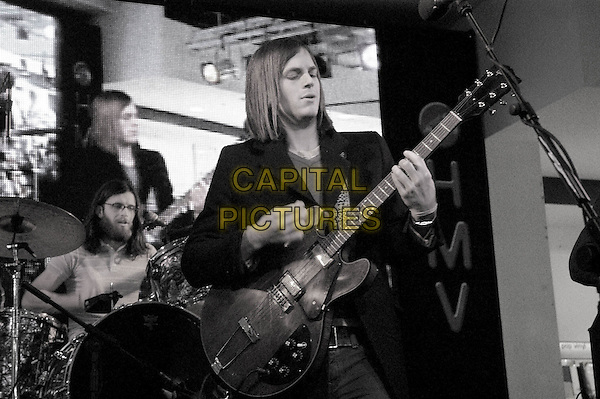 KINGS OF LEON - NATHAN & CALEB FOLLOWILL.HMV Oxford Street.November 1st, 2004.half length, live, performing, stage, gig, guitar.www.capitalpictures.com.sales@capitalpictures.com.©Capital Pictures