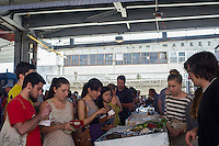 Customers shop at the New Amsterdam Market on South Street in New York on Sunday, June 23, 2013. The market is located in the former Fulton Fish Market with vendors who source their food directly from farmers and producers as well as the farms and makers of artisanal food.  This year because of development of the South Street area the market will only open on one day with the organizers searching for a future permanent home. (© Frances M. Roberts)