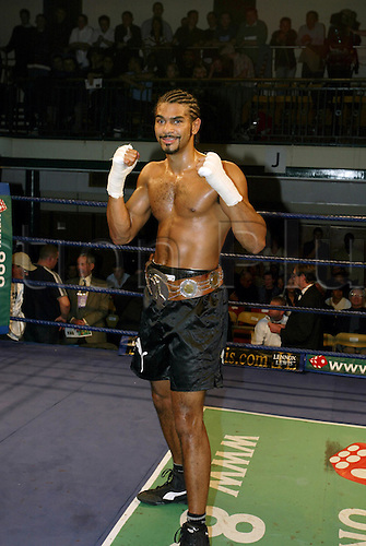 November 14, 2003: DAVID HAYE poses in the ring with the belt after winning the Vacant English Cruiserweight Championship. HAYE stopped Dowling in the first round. York Hall, Bethnal Green, London Photo: Neil Tingle/Action Plus...Boxing 031114 boxer winner winners celebrate celebrates celebration celebrations joy
