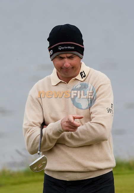Peter Lawrie points to where the line should have been on the 3rd green during the first days play of the Barclays Scottish Open, played over the links at Castle Stuart, Inverness, Scotland from 7th to 10th July 2011:  Picture Stuart Adams /www.golffile.ie  7th July July 2011