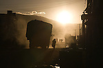 Silhouette of a truck in the dust at sunset in Tingri China.
