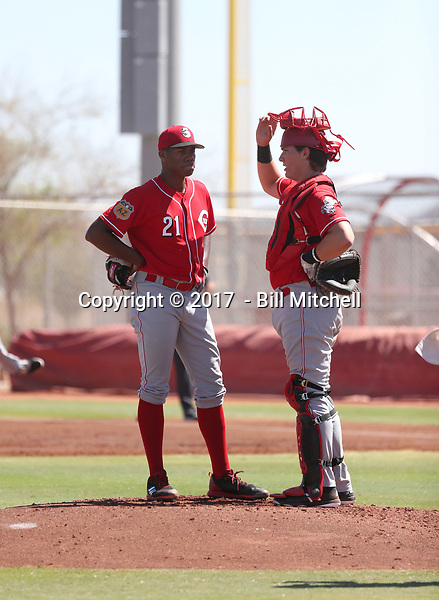 Hunter Greene, the Cincinnati Reds 2017 first round draft pick, pitches against the Rangers in his first instructional league game at the Reds complex on September 25, 2017 in Goodyear, Arizona. Greene talks with catcher Tyler Stephenson during his second inning (Bill Mitchell)