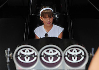 Jun. 29, 2012; Joliet, IL, USA: NHRA young fan gets to sit in the Toyota display funny car during qualifying for the Route 66 Nationals at Route 66 Raceway. Mandatory Credit: Mark J. Rebilas-