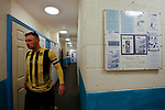 Hebburn's Loius Storey emerges for the second half, next to a selection of framed Penrith programmes. Penrith AFC V Hebburn Town, Northern League Division One, 22nd December 2018. Penrith are the only Cumbrian team in the Northern League. All the other teams are based across the Pennines in the north east.<br />