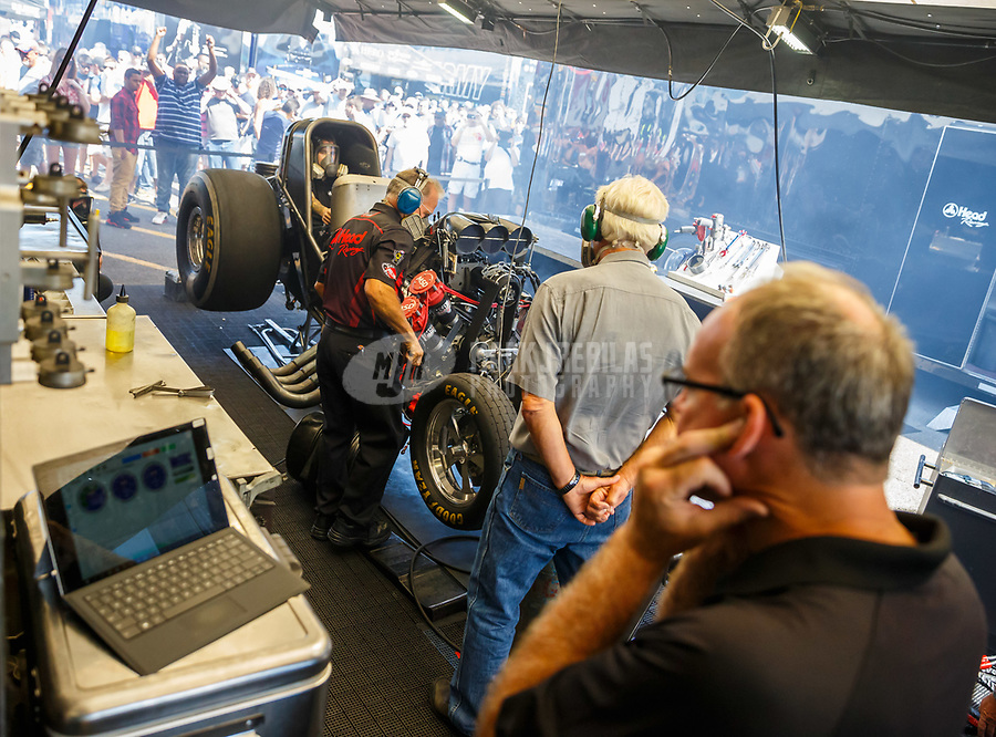 Jun 11, 2017; Englishtown , NJ, USA; Crew members with NHRA funny car driver Jonnie Lindberg as he warms up his car during the Summernationals at Old Bridge Township Raceway Park. Mandatory Credit: Mark J. Rebilas-USA TODAY Sports