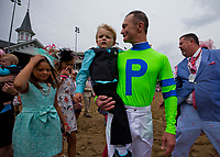 LOUISVILLE, KY - MAY 04: Calvin Borel and his son during the Survivor's Parade on Kentucky Oaks Day at Churchill Downs on May 4, 2018 in Louisville, Kentucky. (Photo by Alex Evers/Eclipse Sportswire/Getty Images)
