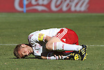 14 JUN 2010: Martin Jorgensen (DEN) grabs his ankle in pain. The Netherlands National Team defeated the Denmark National Team 2-0 at Soccer City Stadium in Johannesburg, South Africa in a 2010 FIFA World Cup Group E match.