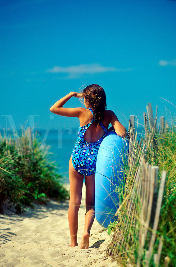 Young girl surveys the beach, Brewster, Cape Cod