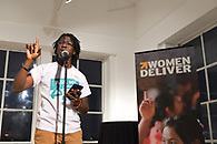 A youth advocate reading poetry during the program.