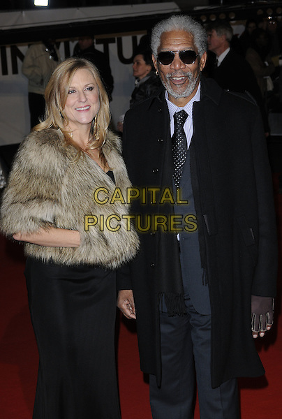 "LORI McCREARY & MORGAN FREEMAN .Attending the ""Invictus'"" UK Film Premiere at the Odeon West End cinema, Leicester Square, London, England, January 31st, 2010. .arrivals half length sunglasses aviators black tie grey gray suit coat beige brown fur jacket 3/4 dress hand in pocket gloves scarf .CAP/CAN.©Can Nguyen/Capital Pictures"