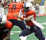 SIOUX FALLS, SD - JUNE 16:  Chris Dixon #2 from the Sioux Falls Storm looks to weave his way through the defense of the  Omaha Beef in the first quarter Saturday night at the Sioux Falls Arena. (Photo by Dave Eggen/Inertia)