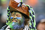 Seattle Seahawks  fan cheers during the game against the Cleveland Browns at CenturyLink Field in Seattle, Washington on December 20, 2015. The Seahawks clinched their fourth straight playoff berth in four seasons by beating the Browns 30-13.  ©2015. Jim Bryant Photo. All Rights Reserved.