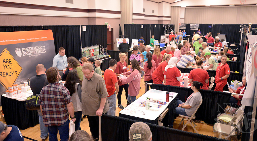 NWA Democrat-Gazette/BEN GOFF @NWABENGOFF<br /> Guest peruse the booths on Saturday Sept. 12, 2015 during the Northwest Arkansas Emergency Preparedness Fair at the Church of Jesus Christ of Latter-Day Saints in Bentonville. The event included a variety of informational booths, a blood drive, games for children, appearances by emergency vehicles and meteorology classes to help families be prepared for emergencies.