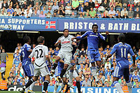 Pictured L-R: Battling for  a header Ashley Williams of Swansea against Mikel of Chelsea. Saturday 17 September 2011<br /> Re: Premiership football Chelsea FC v Swansea City FC at the Stamford Bridge Stadium, London.