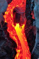 Small lava flow and faces, Kilauea volcano, Hawaii Volcanoes National Park, Big Island, Hawaii, USA