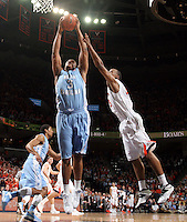 North Carolina forward Kennedy Meeks (3) grabs the rebound next to Virginia forward Akil Mitchell (25) during an NCAA basketball game against Virginia Monday Jan. 20, 2014 in Charlottesville, VA. Virginia defeated North Carolina 76-61.