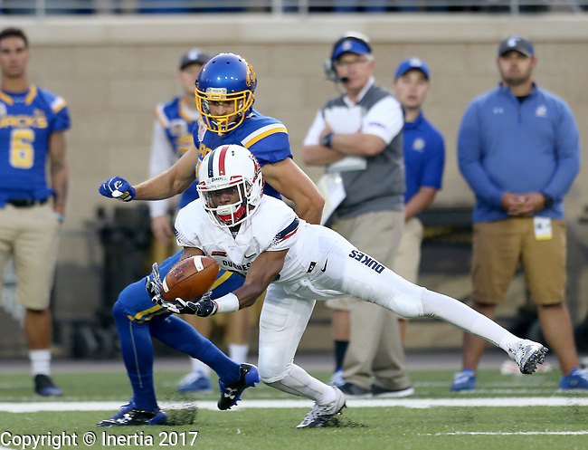 BROOKINGS, SD - AUGUST 31: Malek Shegog #10 from Duquesne dives to intercept a pass in front of Jake Wieneke #19 from South Dakota State University in the first half of their game Thursday night at Dana J. Dykhouse Stadium in Brookings. (Photo by Dave Eggen/Inertia)