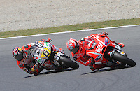 16.06.2013 Barcelona, Spain. Aperol Grand Prix of Catalonia. Picture show Nicky Hayden (Ducati) and Stefan Bradl (Honda) in action during Moto GP Racing  at Circuit de Catalunya