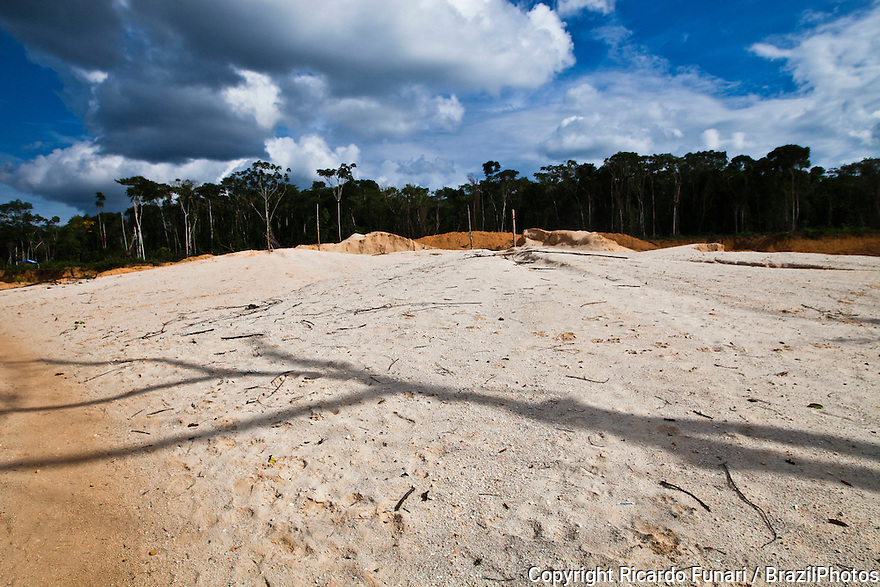 Amazon rain forest deforestation, forest bacame desert after hydraulic mining was performed, a form of mining that uses high-pressure jets of water to dislodge rock material or move sediment. Agua Branca gold mining village, , Para State, Brazil.