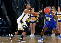 Florida International University guard Kamika Idom (14) plays against Lynn University.  FIU won the game 68-30 on November 30, 2011 at Miami, Florida. .
