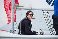 Crew Emma Sexton,'20, readies to bail water as the Salve Regina Sailing Team practices in Newport Habor.