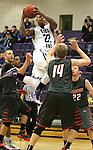 SIOUX FALLS, SD - JANUARY 16:  Charles Ward #22 from the University of Sioux Falls takes the ball to the basket against Aaron Lien #14 from Minnesota Moorhead in the first half of their game Friday night at the Stewart Center.  (Photo by Dave Eggen/Inertia)