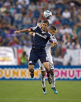 New England Revolution midfielder Chris Tierney (8) and Los Angeles Galaxy defender Sean Franklin (28) battle for head ball. The New England Revolution defeated LA Galaxy, 2-0, at Gillette Stadium on July 10, 2010.