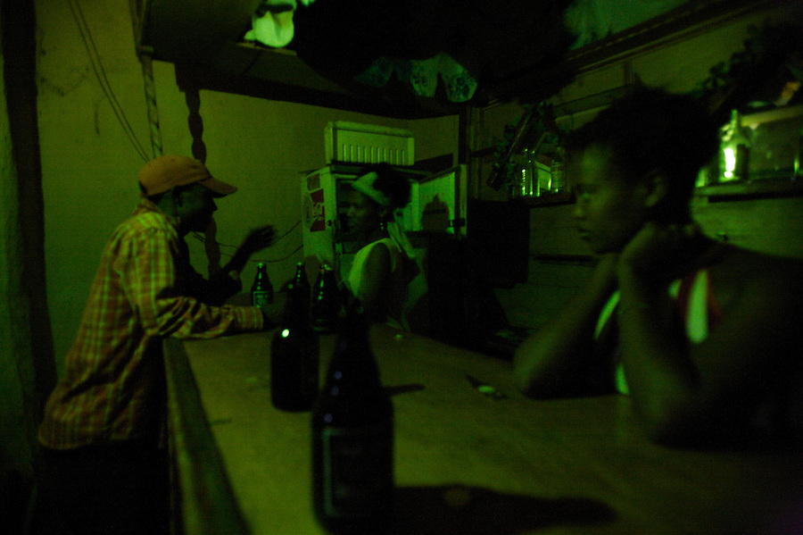 Asmar and Jenno, two sex workers, wait for customers at the bar where they work in Babile. Ethiopia on thursday June 08 2006..tens of young girls work in small bars in the boarder town of Babile, where the rat of HIV infections is among the highest in the country. they seel their bodies for less than 2 USD. None of these girls test for HIV and frequently are frequently forced into unprotected sex..Ethiopia is one of the countries most affected by HIV/AIDS. Of its population of 77 million, three million are HIV-positive, according to government statistics. Every day sees 1,000 new infections. A million children under 14 have lost one or both parents to AIDS, and 200,000 children are living with AIDS. That makes Ethiopia the country with the most HIV-positive children.