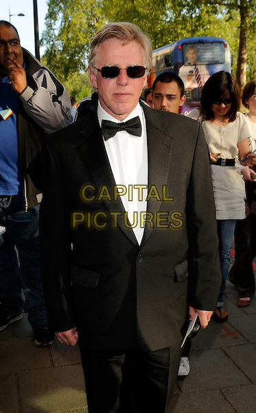 PHIL DAVIS.The British Academy TV Craft Awards, Dorchester hotel, London, England..May 11th, 2008.BAFTA half length black tuxedo jacket bow tie sunglasses shades .CAP/CAN.©Can Nguyen/Capital Pictures.