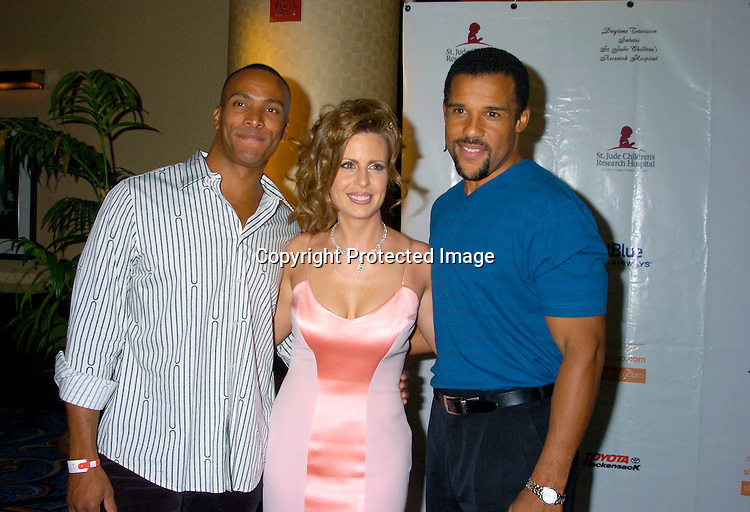Mike Woods, Martha Byrne and Peter Parros ..at the 10th Annual Daytime Television Salutes St. Jude Children's Research Hospital Benefit on October 8, 2004 at the Marriott Marquis Hotel in New York City...Photo by Robin Platzer, Twin Images
