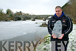 River Feale Frozen : Stephen O'Sullivan, Tarbert holding a slab of ice , 2cm thick taken from the River Feale which was entirely frozen over  in Listowel on Tuesday.