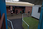 The referee waiting for the teams to emerge from the changing rooms before Cambrian and Clydach Vale take on Cwmbran Celtic at King George's New Field in a Welsh League Division One match, the top division of the Welsh Football League and the second level of the Welsh football league system. The club, formed in 1965 reached the final of the 2018-19 League Cup final and can count on ex-England manager Terry Venables as a former club chairman. Cambrian and Clydach Vale won this match 2-0, watch by a crowd of around 100 spectators.