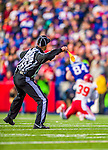 9 November 2014: NFL back judge Tony Steratore throws a flag for offensive interference on Buffalo Bills tight end Scott Chandler as he is tackled by Kansas City Chiefs free safety Husain Abdullah in the fourth quarter at Ralph Wilson Stadium in Orchard Park, NY. The Chiefs rallied with two fourth quarter touchdowns to defeat the Bills 17-13. Mandatory Credit: Ed Wolfstein Photo *** RAW (NEF) Image File Available ***