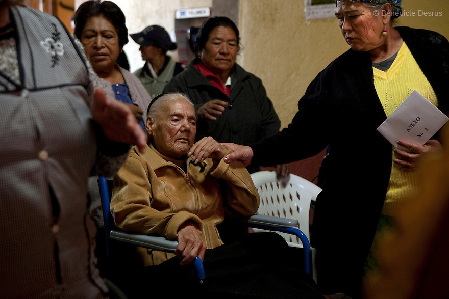Amalia, a resident of Casa Xochiquetzal, comforts Consuelo during a christmas mass at the shelter in Mexico City, Mexico on December 11, 2008. Casa Xochiquetzal is a shelter for elderly sex workers in Mexico City. It gives the women refuge, food, health services, a space to learn about their human rights and courses to help them rediscover their self-confidence and deal with traumatic aspects of their lives. Casa Xochiquetzal provides a space to age with dignity for a group of vulnerable women who are often invisible to society at large. It is the only such shelter existing in Latin America. Photo by Bénédicte Desrus
