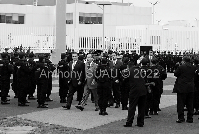 Mexico City, Mexico<br /> June 16, 2008<br /> <br /> (L-R) Secretary of Public Security Genaro Garcia Luna and Mexico's President Felipe Calderon at the opening of a new high-tech federal police center. The first of ten scheduled to open around the country.