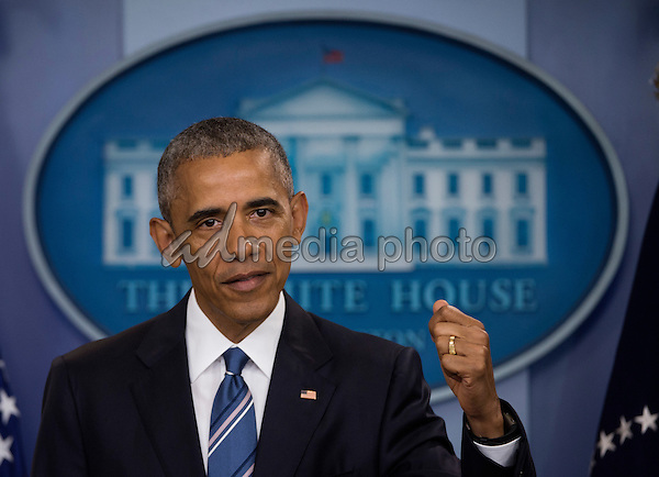 United States President Barack Obama takes questions after delivering remarks on the US Supreme Court decision on immigration in the press briefing room of the White House in Washington, DC, USA, 23 June 2016. Photo Credit: Molly Riley/CNP/AdMedia