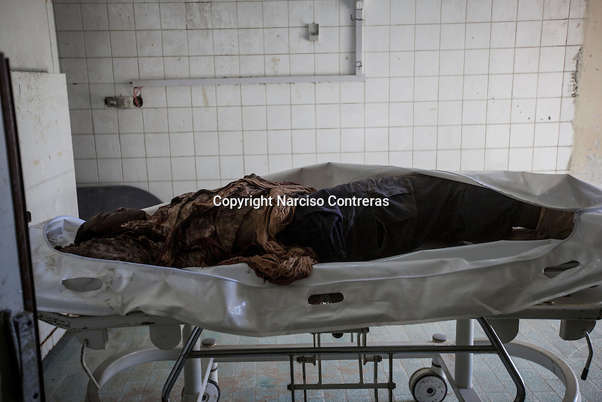 Sunday 22, May 2016: The body of a dead ISIL fighter lays at the morgue of Misrata, Libya.