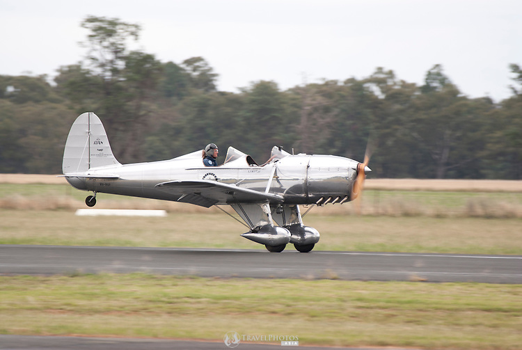 A Ryan STM S2 of the Temora Aviation Museum taking off on a rainy day