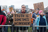 """Dan Hart, of West Roxbury, Boston, Mass., holds a sign reading """"Truth is sometimes inconvenient"""" as people gather in Boston Common in Boston, Massachusetts, for  the March for Science demonstration on Sat., April 22, 2017. Hart said he made the sign himself. """"It's one of the things that scares me most about the current administration. They run from the truth. They manipulate the truth."""""""