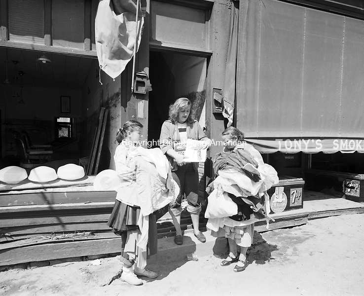 Gathering supplies from the Salvation Army after the flood.