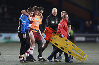Picture by Paul Greenwood/SWpix.com - 27/04/2018 - Rugby League - Betfred Super League - Widnes Vikings v Wigan Warriors - Select Security Stadium, Widnes, England - Joe Burgess of Wigan Warriors leaves the field of play after injuring his knee