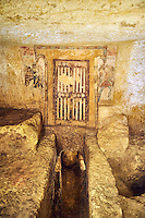 """Underground Etruscan tomb """"Tomba dei Caronti"""" made about 150-125 BC. This tomb has a higher level with 2 painted false doors that was furnished with seats as was probably used for religious functions, steps lead down to a lower burial chamber. Excavated 1960 , Etruscan Necropolis of Monterozzi, Monte del Calvario, Tarquinia, Italy. A UNESCO World Heritage Site."""
